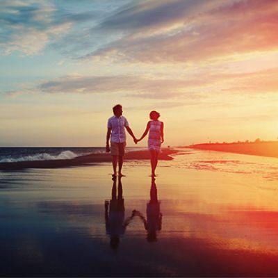 couple-walking-sunset
